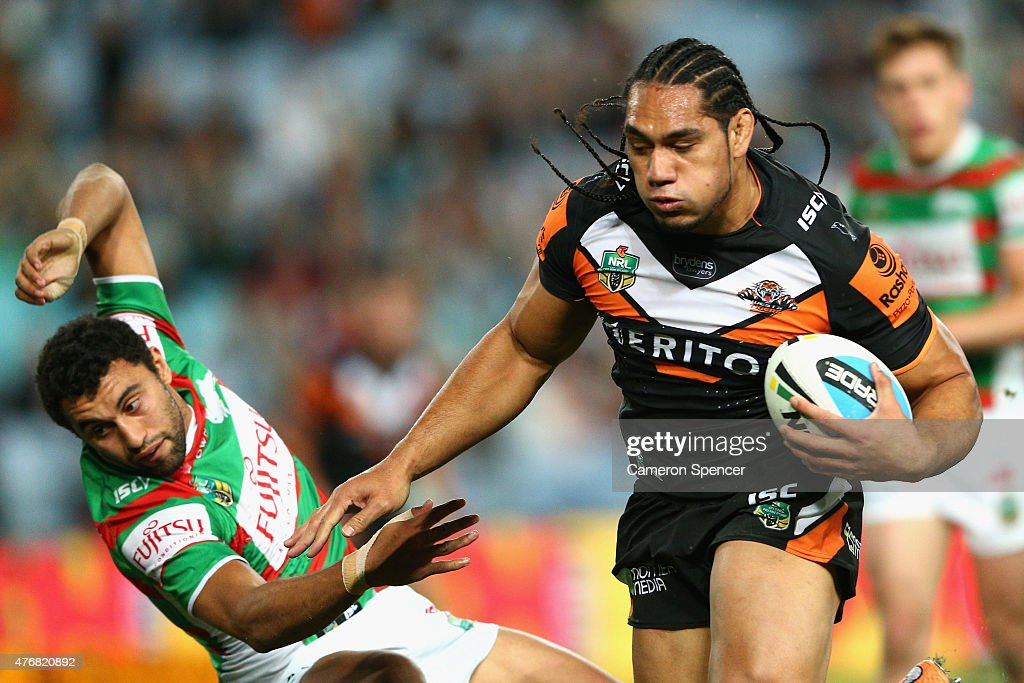Martin Taupau of the Tigers heads for the tryline dring the round 14 NRL match between the Wests Tigers and the South Sydney Rabbitohs at ANZ Stadium on June 12, 2015 in Sydney, Australia.