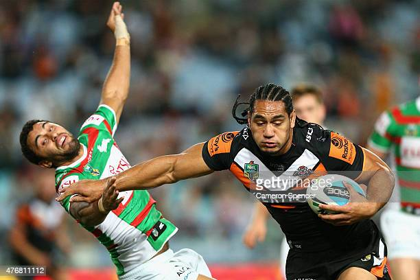 Martin Taupau of the Tigers makes a break during the round 14 NRL match between the Wests Tigers and the South Sydney Rabbitohs at ANZ Stadium on...