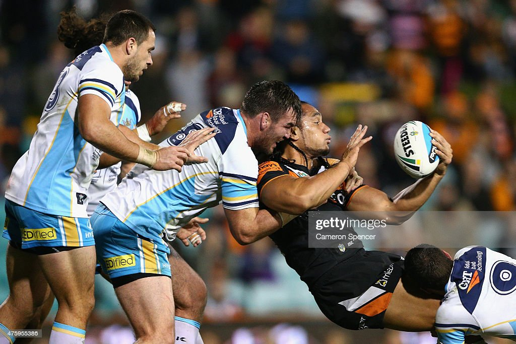 Martin Taupau of the Tigers offloads the ball in a tackle during the round 13 NRL match between the Wests Tigers and the Gold Coast Titans at Leichhardt Oval on June 5, 2015 in Sydney, Australia.