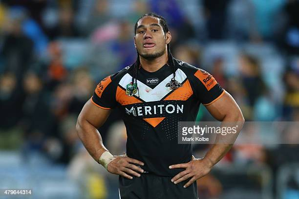Martin Taupau of the Wests Tigers looks dejected during the round 17 NRL match between the Wests Tigers and the Parramatta Eels at ANZ Stadium on...