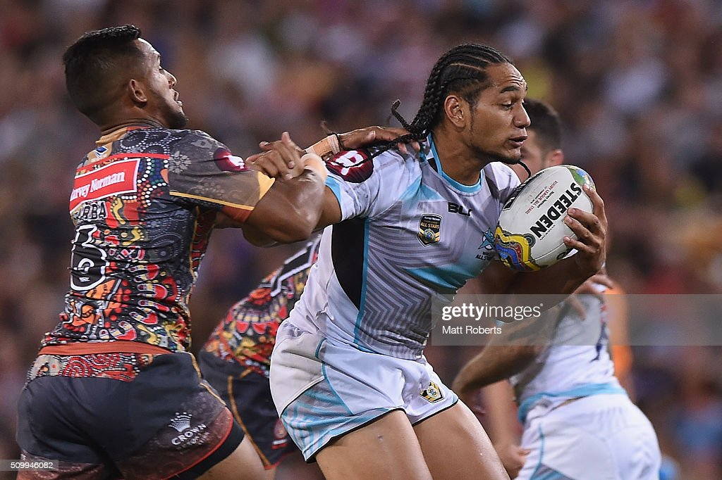 Martin Taupau of the World All Stars is tackled during the NRL match between the Indigenous All-Stars and the World All-Stars at Suncorp Stadium on February 13, 2016 in Brisbane, Australia.