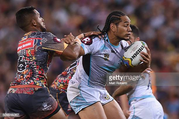 Martin Taupau of the World All Stars is tackled during the NRL match between the Indigenous AllStars and the World AllStars at Suncorp Stadium on...