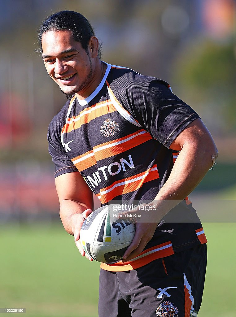 Martin Taupau smiles during a Wests Tigers NRL training session at Concord Oval on August 6, 2014 in Sydney, Australia.