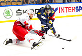 Martin Thornberg of HV71 battles with Thomas Raffl of Red Bull Salzburg during the Champions Hockey League group stage game between HV71 Jonkoping...