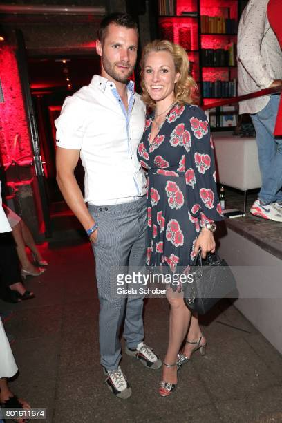 MUNICH GERMANY JUNE 26 Martin Tomczyk DTM Champion and his wife Christina Surer during the Movie meets Media Party during the Munich Film Festival on...