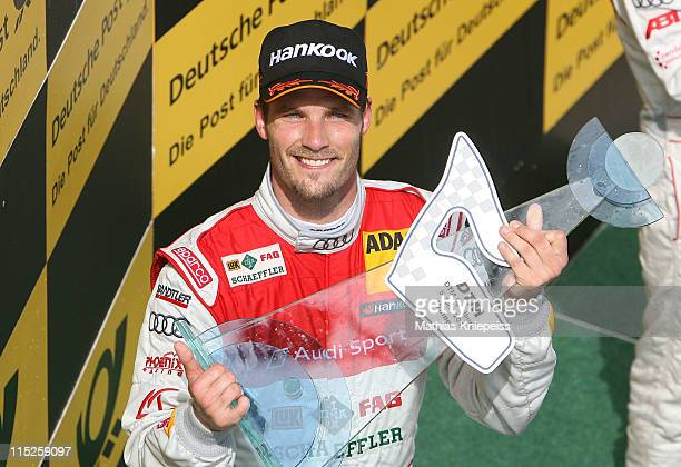 Martin Tomczyk from Germany celebrates his victory during the DTM 2011 German Touring Car Championship at Red Bull Ring on June 5 2011 in Spielberg...