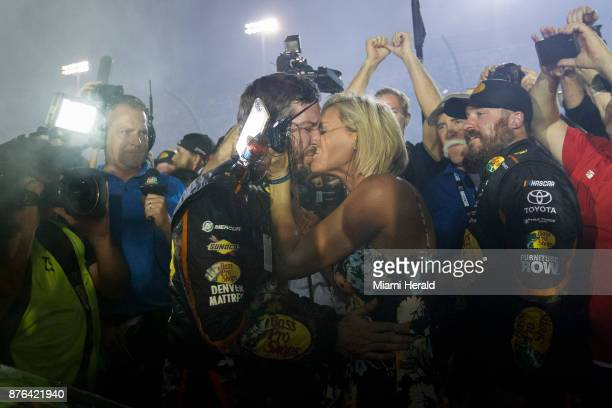 Martin Truex Jr #78 gets a kiss from his wife after winning the Monster Energy NASCAR Cup Series and the Ford EcoBoost 400 Championships on Sunday...