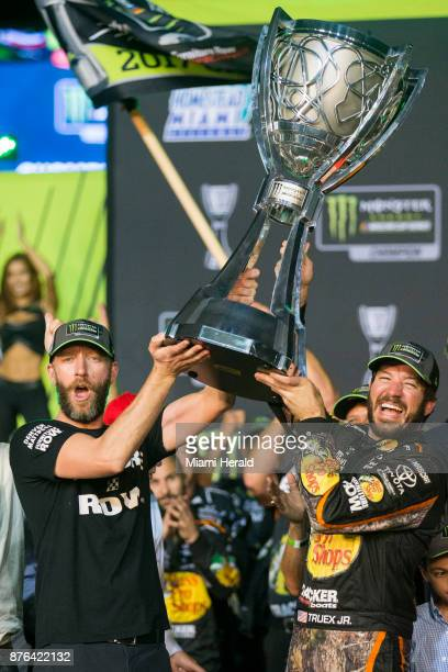 Martin Truex Jr #78 holds his trophy after winning the Monster Energy NASCAR Cup Series and the Ford EcoBoost 400 Championships on Sunday Nov 19 2017...