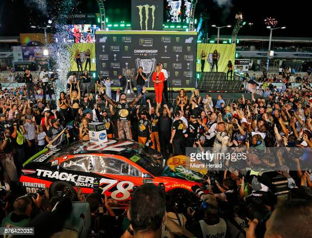 Martin Truex Jr celebrates as he wins the Monster Energy NASCAR Cup Series Championship and EcoBoost 400 on Sunday Nov 19 2017 at the HomesteadMiami...