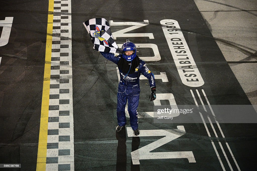 Martin Truex, Jr., driver of the #78 Auto-Owners Insurance Toyota, celebrates after winning the NASCAR Sprint Cup Series Bojangles' Southern 500 at Darlington Raceway on September 4, 2016 in Darlington, South Carolina.