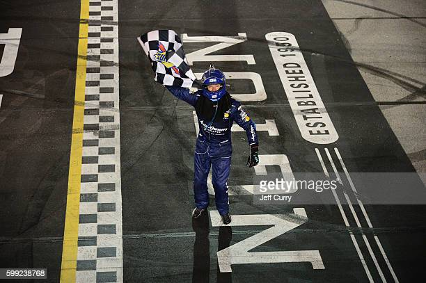 Martin Truex Jr driver of the AutoOwners Insurance Toyota celebrates after winning the NASCAR Sprint Cup Series Bojangles' Southern 500 at Darlington...