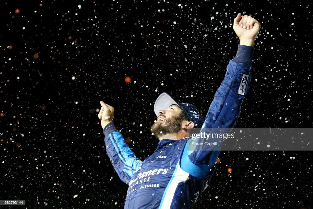 Martin Truex Jr., driver of the #78 Auto-Owners Insurance Toyota, celebrates in Victory Lane after winning the Monster Energy NASCAR Cup Series Go Bowling 400 at Kansas Speedway on May 13, 2017 in Kansas City, Kansas.