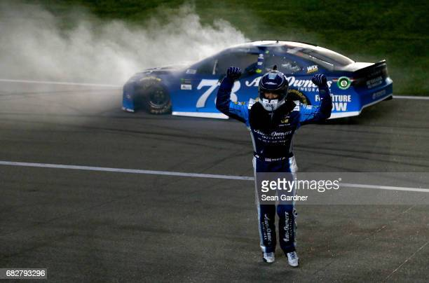 Martin Truex Jr driver of the AutoOwners Insurance Toyota celebrates after a burnout after winning the Monster Energy NASCAR Cup Series Go Bowling...