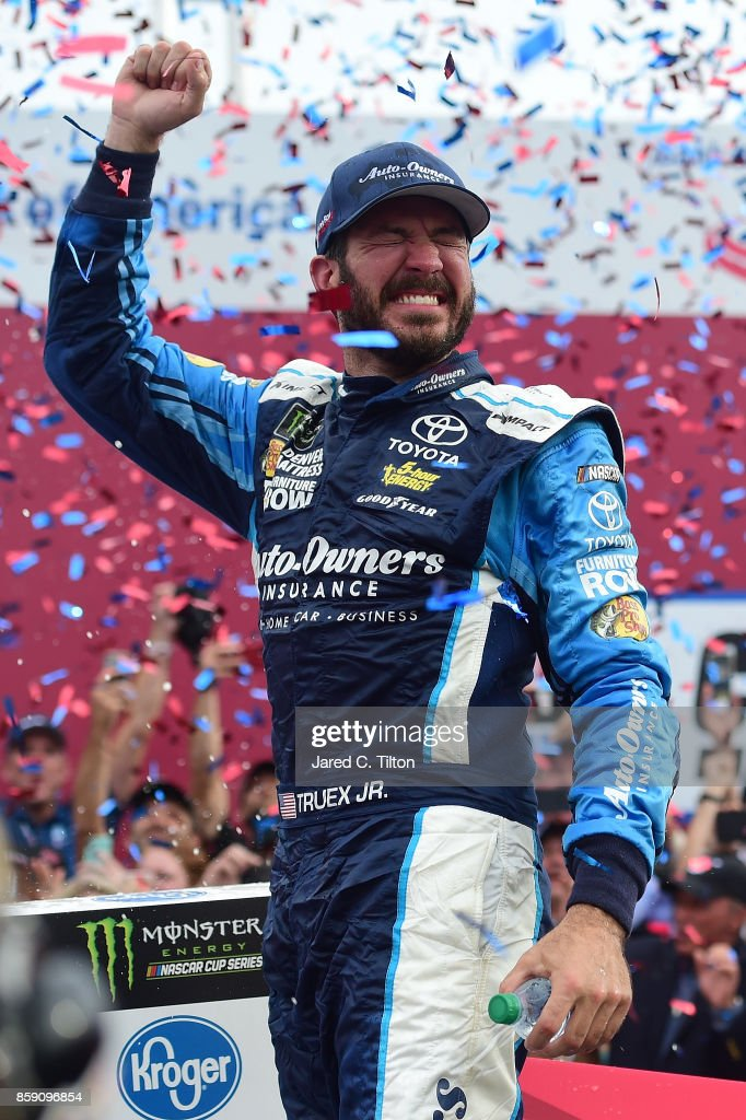 Martin Truex Jr, driver of the #78 Auto-Owners Insurance Toyota, celebrates in Victory Lane after winning the Monster Energy NASCAR Cup Series Bank of America 500 at Charlotte Motor Speedway on October 8, 2017 in Charlotte, North Carolina.