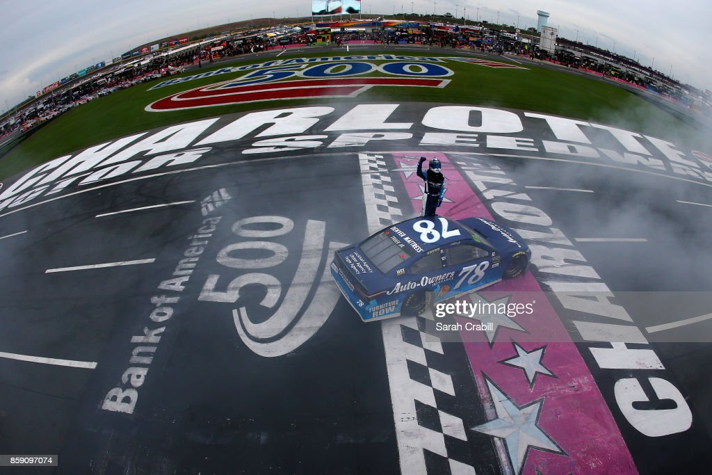 Martin Truex Jr, driver of the #78 Auto-Owners Insurance Toyota, celebrates after winning the Monster Energy NASCAR Cup Series Bank of America 500 at Charlotte Motor Speedway on October 8, 2017 in Charlotte, North Carolina.
