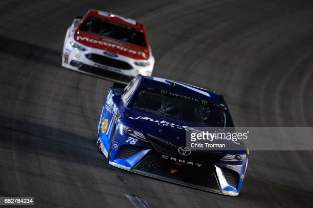 Martin Truex Jr driver of the AutoOwners Insurance Toyota leads Ryan Blaney driver of the Motorcraft/Quick Lane Tire Auto Center Ford during the...