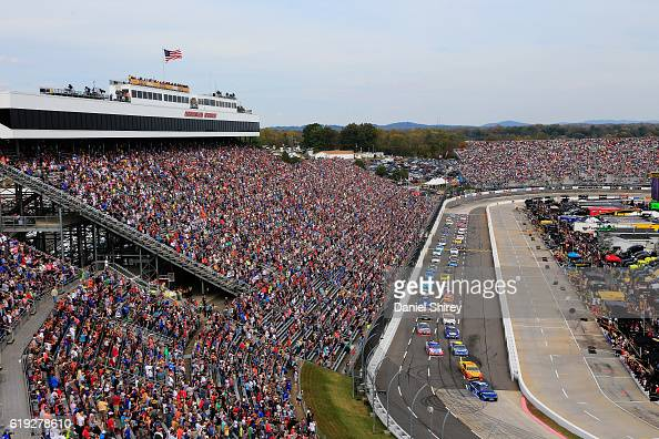 Martin Truex Jr driver of the AutoOwners Insurance Toyota leads the field past the green flag on the first lap of the NASCAR Sprint Cup Series...
