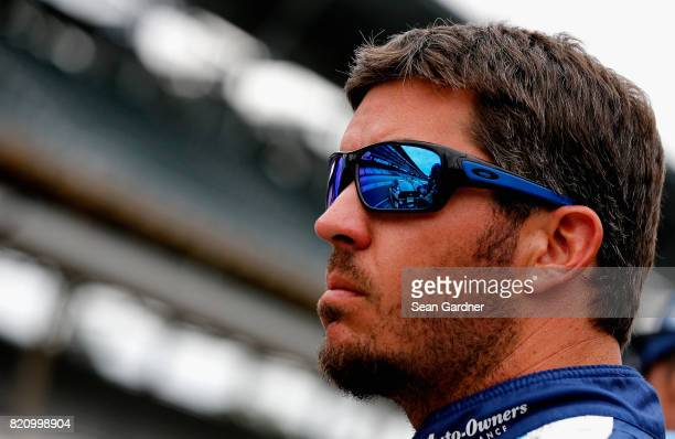 Martin Truex Jr driver of the AutoOwners Insurance Toyota looks on during qualifying for the Monster Energy NASCAR Cup Series Brickyard 400 at...