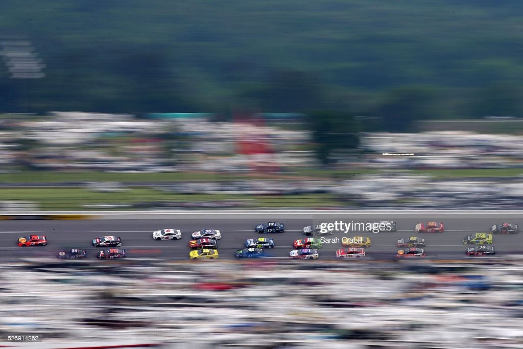 Martin Truex Jr, driver of the #78 Bass Pro Shops/TRACKER Boats Toyota, leads a pack of cars during the NASCAR Sprint Cup Series GEICO 500 at Talladega Superspeedway on May 1, 2016 in Talladega, Alabama.