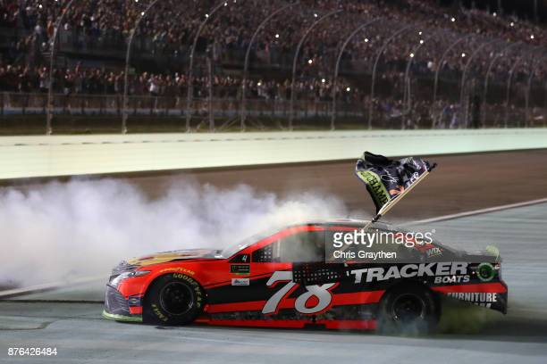 Martin Truex Jr driver of the Bass Pro Shops/Tracker Boats Toyota celebrates with a burnout after winning the Monster Energy NASCAR Cup Series...