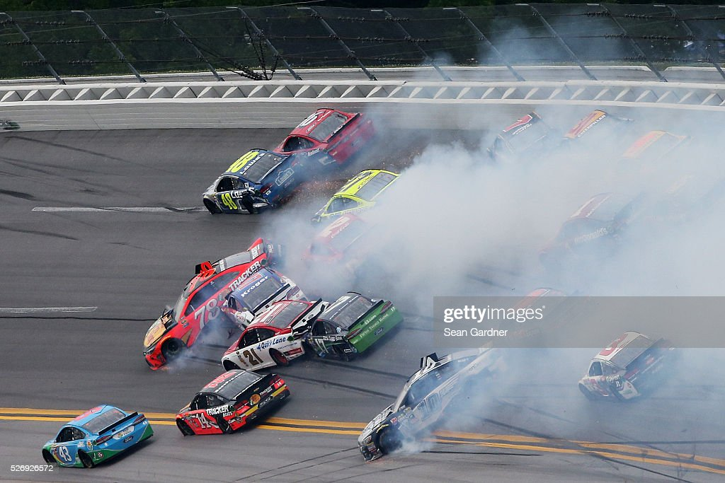 Martin Truex Jr, driver of the #78 Bass Pro Shops/TRACKER Boats Toyota, and others are involved in a large on track incident during the NASCAR Sprint Cup Series GEICO 500 at Talladega Superspeedway on May 1, 2016 in Talladega, Alabama.