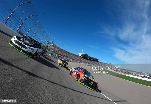 Martin Truex Jr driver of the Bass Pro Shops/Tracker Boats Toyota and Kevin Harvick driver of the Jimmy John's Ford lead the field prior to the start...