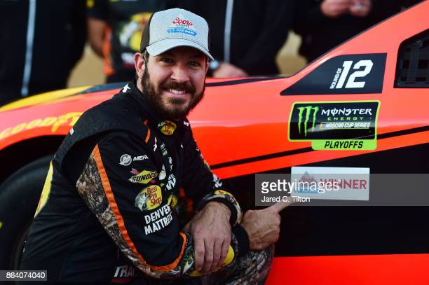 Martin Truex Jr driver of the Bass Pro Shops/Tracker Boats Toyota poses for a photo after winning the pole award during qualifying for the Monster...