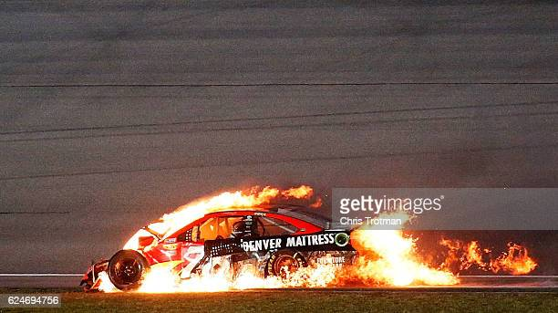 Martin Truex Jr driver of the Bass Pro Shops/TRACKER Boats Toyota is involved in an ontrack incident during the NASCAR Sprint Cup Series Ford...