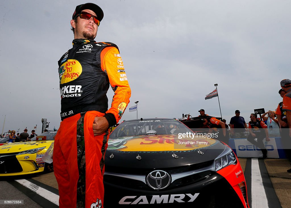 Martin Truex Jr, driver of the #78 Bass Pro Shops/TRACKER Boats Toyota, stands on the grid during qualifying for the NASCAR Sprint Cup Series GEICO 500 at Talladega Superspeedway on April 30, 2016 in Talladega, Alabama.