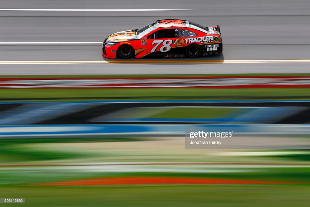 Martin Truex Jr, driver of the #78 Bass Pro Shops/TRACKER Boats Toyota, races during practice for the NASCAR Sprint Cup Series GEICO 500 at Talladega Superspeedway on April 29, 2016 in Talladega, Alabama.