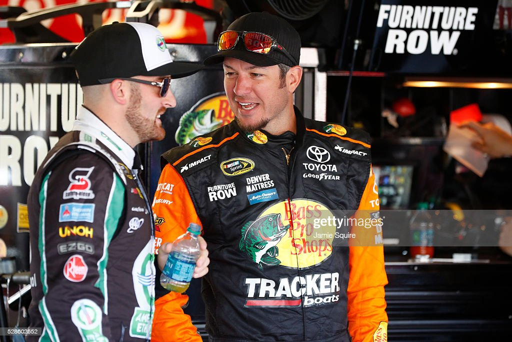 <a gi-track='captionPersonalityLinkClicked' href=/galleries/search?phrase=Martin+Truex+Jr.&family=editorial&specificpeople=184514 ng-click='$event.stopPropagation()'>Martin Truex Jr.</a>, driver of the #78 Bass Pro Shops/TRACKER Boats Toyota Toyota, talks with <a gi-track='captionPersonalityLinkClicked' href=/galleries/search?phrase=Austin+Dillon&family=editorial&specificpeople=5075945 ng-click='$event.stopPropagation()'>Austin Dillon</a>, driver of the #3 American Ethanol Chevrolet, during practice for the NASCAR Sprint Cup Series Go Bowling 400 at Kansas Speedway on May 6, 2016 in Kansas City, Kansas.