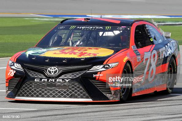 Martin Truex Jr driver of the Bass Pro Shops/Tracker Boats Toyota during practice for the NASCAR Monster Energy Cup Series Daytona 500 on February 24...