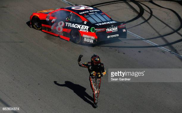 Martin Truex Jr driver of the Bass Pro Shops/TRACKER BOATS Toyota celebrates after winning the Monster Energy NASCAR Cup Series Kobalt 400 at Las...