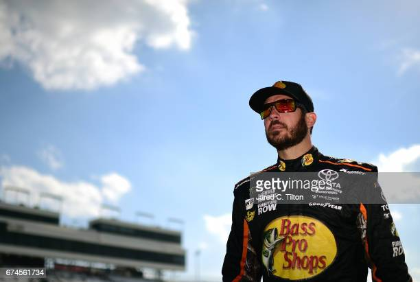 Martin Truex Jr driver of the Bass Pro Shops/TRACKER BOATS Toyota walks down pit road during qualifying for the Monster Energy NASCAR Cup Series...
