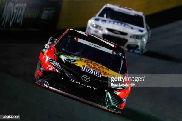 Martin Truex Jr driver of the Bass Pro Shops/Tracker Boats Toyota leads Jimmie Johnson driver of the Lowe's Chevrolet during the Monster Energy...