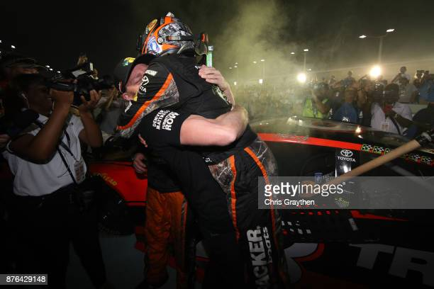 Martin Truex Jr driver of the Bass Pro Shops/Tracker Boats Toyota celebrates with teammates after winning the Monster Energy NASCAR Cup Series...