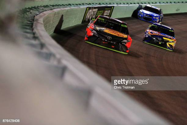 Martin Truex Jr driver of the Bass Pro Shops/Tracker Boats Toyota leads Kyle Busch driver of the MM's Caramel Toyota and Kyle Larson driver of the...