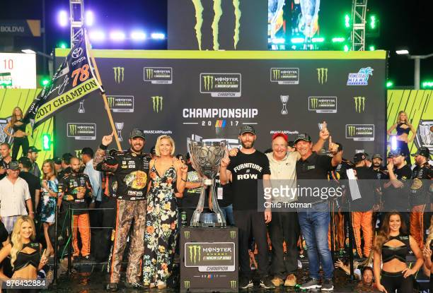 Martin Truex Jr driver of the Bass Pro Shops/Tracker Boats Toyota celebrates with girlfriend Sherry Pollex and crew chief Cole Pearn in Victory Lane...