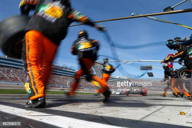 Martin Truex Jr driver of the Bass Pro Shops/TRACKER BOATS Toyota pits during the Monster Energy NASCAR Cup Series Kobalt 400 at Las Vegas Motor...