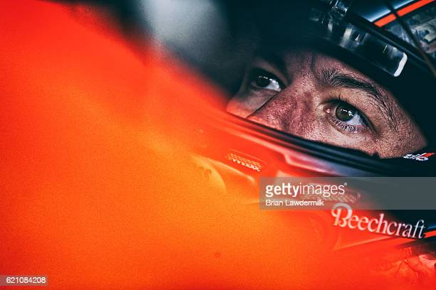 Martin Truex Jr driver of the Bass Pro Shops/TRACKER Boats Toyota sits in his car during practice for the NASCAR Sprint Cup Series AAA Texas 500 at...