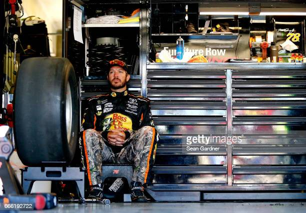 Martin Truex Jr driver of the Bass Pro Shops/TRACKER BOATS Toyota sits in the garage area during practice for the Monster Energy NASCAR Cup Series...