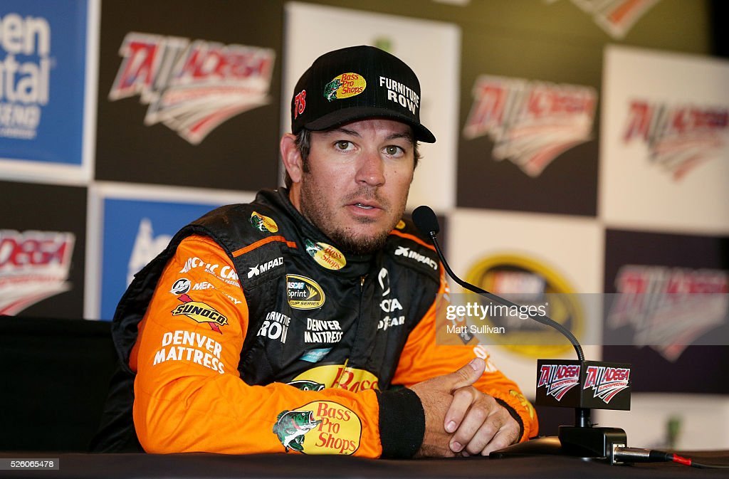 Martin Truex Jr, driver of the #78 Bass Pro Shops/TRACKER Boats Toyota, speaks to the media during a press conference prior to practice for the NASCAR Sprint Cup Series GEICO 500 at Talladega Superspeedway on April 29, 2016 in Talladega, Alabama.