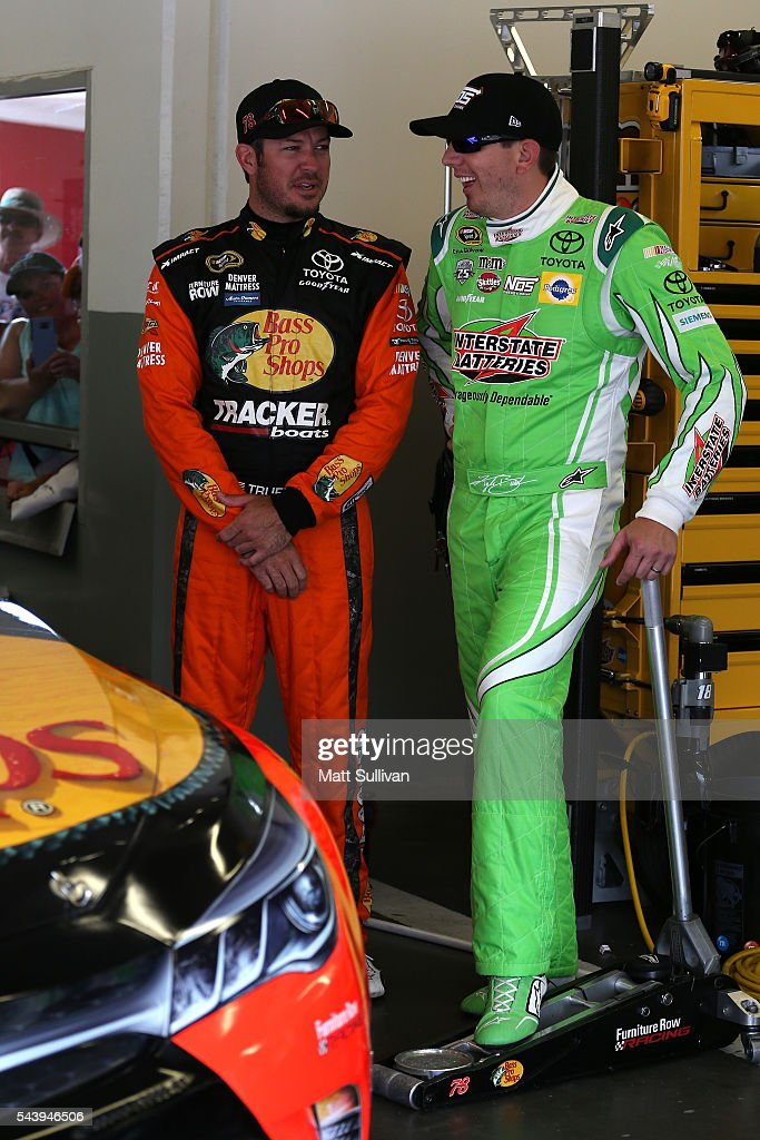 <a gi-track='captionPersonalityLinkClicked' href=/galleries/search?phrase=Martin+Truex+Jr.&family=editorial&specificpeople=184514 ng-click='$event.stopPropagation()'>Martin Truex Jr.</a>, driver of the #78 Bass Pro Shops/Tracker Boats Toyota, talks to <a gi-track='captionPersonalityLinkClicked' href=/galleries/search?phrase=Kyle+Busch&family=editorial&specificpeople=211123 ng-click='$event.stopPropagation()'>Kyle Busch</a>, driver of the #18 Interstate Batteries Toyota, in the garage area during practice for the NASCAR Sprint Cup Series Coke Zero 400 at Daytona International Speedway on June 30, 2016 in Daytona Beach, Florida.