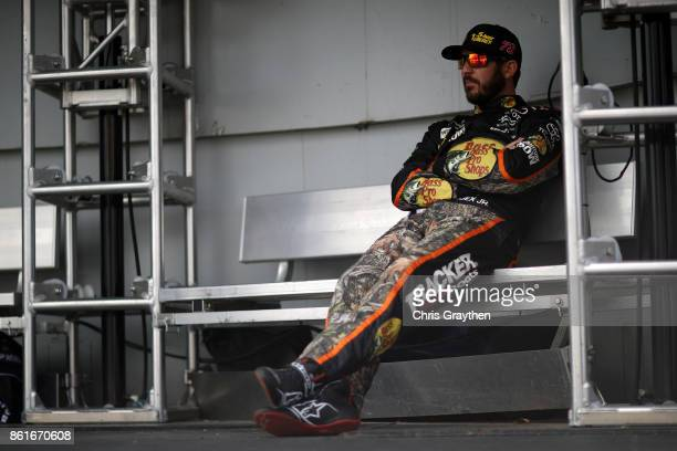 Martin Truex Jr driver of the Bass Pro Shops/Tracker Boats Toyota waits to be introduced prior to the Monster Energy NASCAR Cup Series Alabama 500 at...