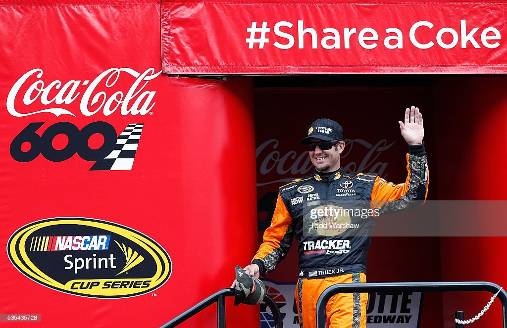 <a gi-track='captionPersonalityLinkClicked' href=/galleries/search?phrase=Martin+Truex+Jr.&family=editorial&specificpeople=184514 ng-click='$event.stopPropagation()'>Martin Truex Jr.</a>, driver of the #78 Bass Pro Shops/Tracker Toyota, is introduced prior to the NASCAR Sprint Cup Series Coca-Cola 600 at Charlotte Motor Speedway on May 29, 2016 in Charlotte, North Carolina.