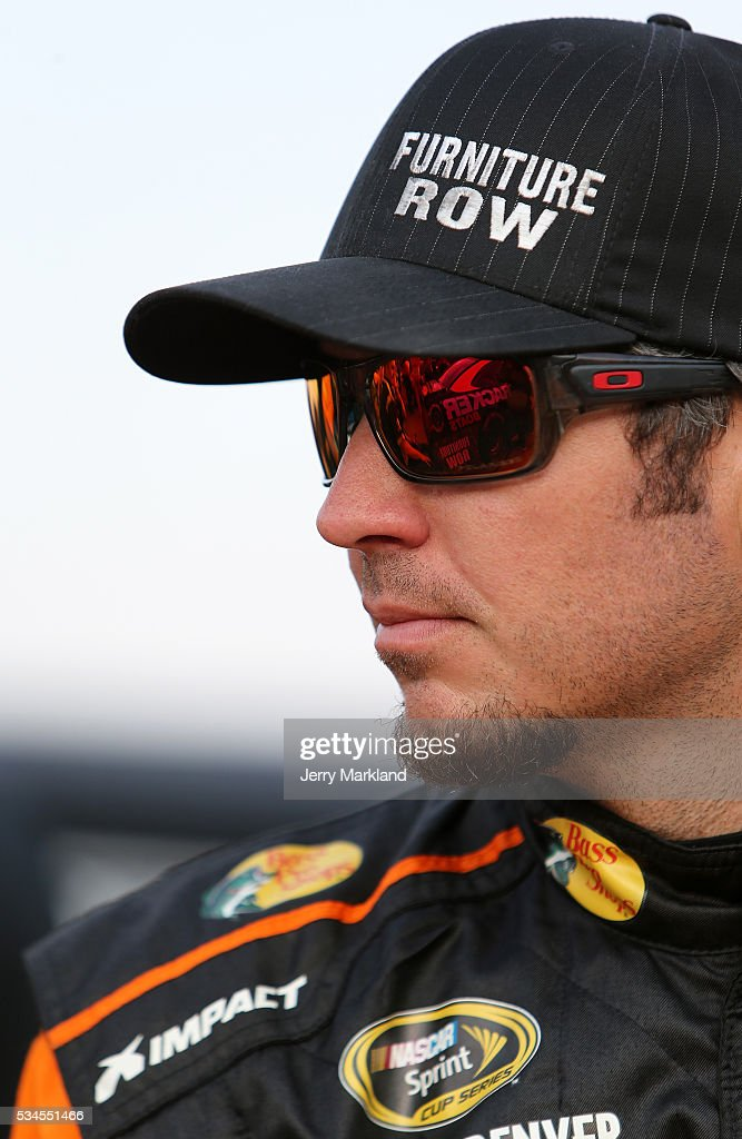 <a gi-track='captionPersonalityLinkClicked' href=/galleries/search?phrase=Martin+Truex+Jr.&family=editorial&specificpeople=184514 ng-click='$event.stopPropagation()'>Martin Truex Jr.</a>, driver of the #78 Bass Pro Shops/Tracker Toyota, looks on during qualifying for the NASCAR Sprint Cup Series Coca-Cola 600 at Charlotte Motor Speedway on May 27, 2016 in Charlotte, North Carolina.