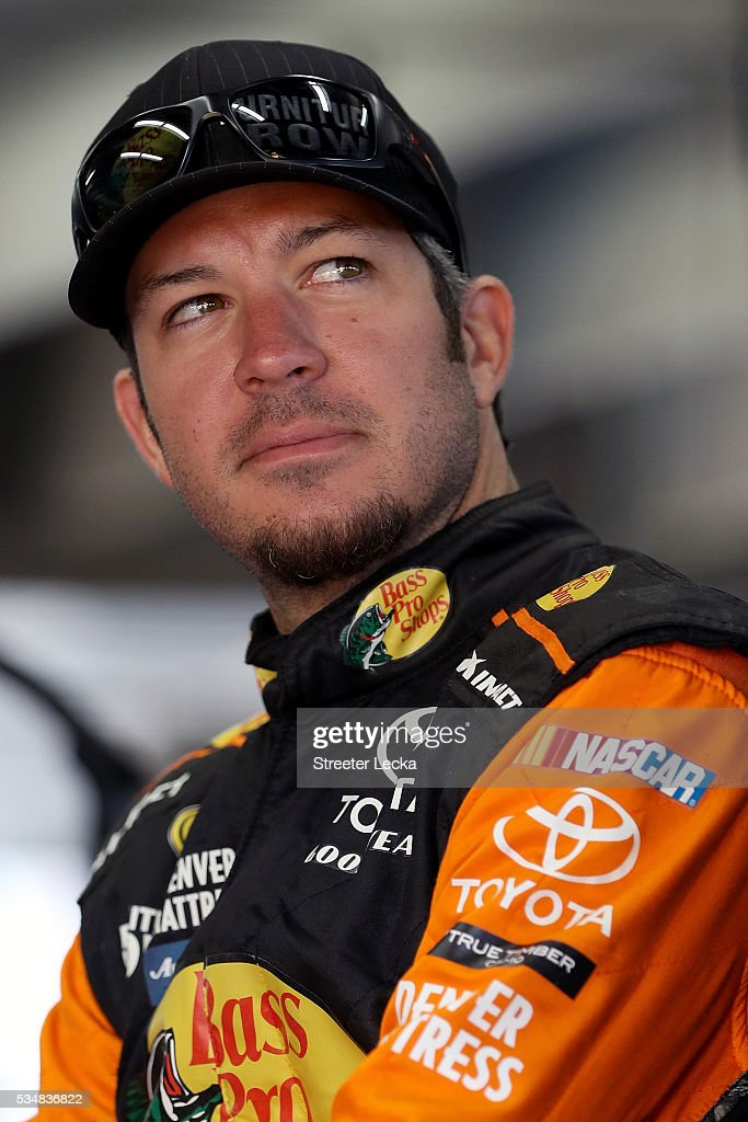 <a gi-track='captionPersonalityLinkClicked' href=/galleries/search?phrase=Martin+Truex+Jr.&family=editorial&specificpeople=184514 ng-click='$event.stopPropagation()'>Martin Truex Jr.</a>, driver of the #78 Bass Pro Shops/Tracker Toyota, looks on from the garage area during practice for the NASCAR Sprint Cup Series Coca-Cola 600 at Charlotte Motor Speedway on May 28, 2016 in Charlotte, North Carolina.
