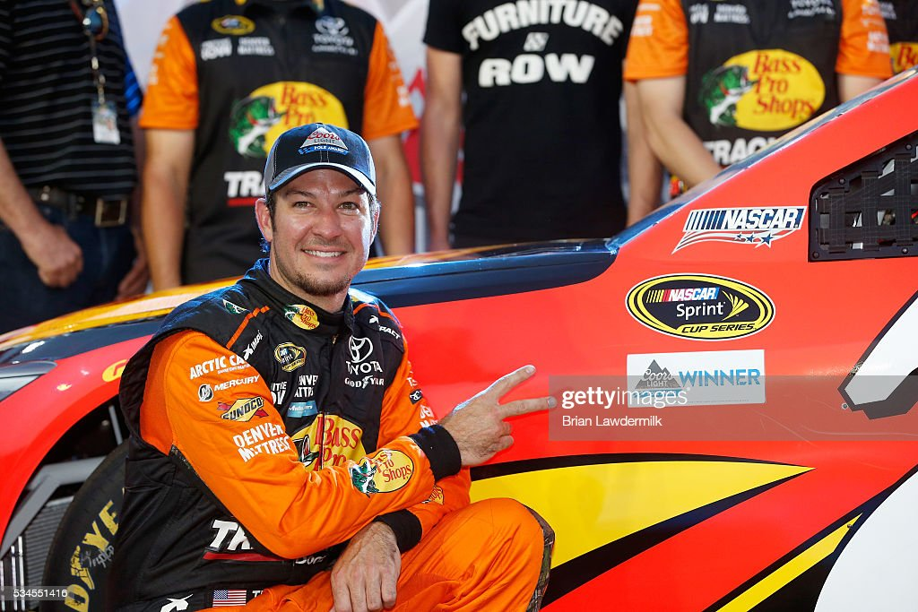 <a gi-track='captionPersonalityLinkClicked' href=/galleries/search?phrase=Martin+Truex+Jr.&family=editorial&specificpeople=184514 ng-click='$event.stopPropagation()'>Martin Truex Jr.</a>, driver of the #78 Bass Pro Shops/Tracker Toyota, poses with the Coors Light Pole Award after qualifying for pole position for the NASCAR Sprint Cup Series Coca-Cola 600 at Charlotte Motor Speedway on May 27, 2016 in Charlotte, North Carolina.