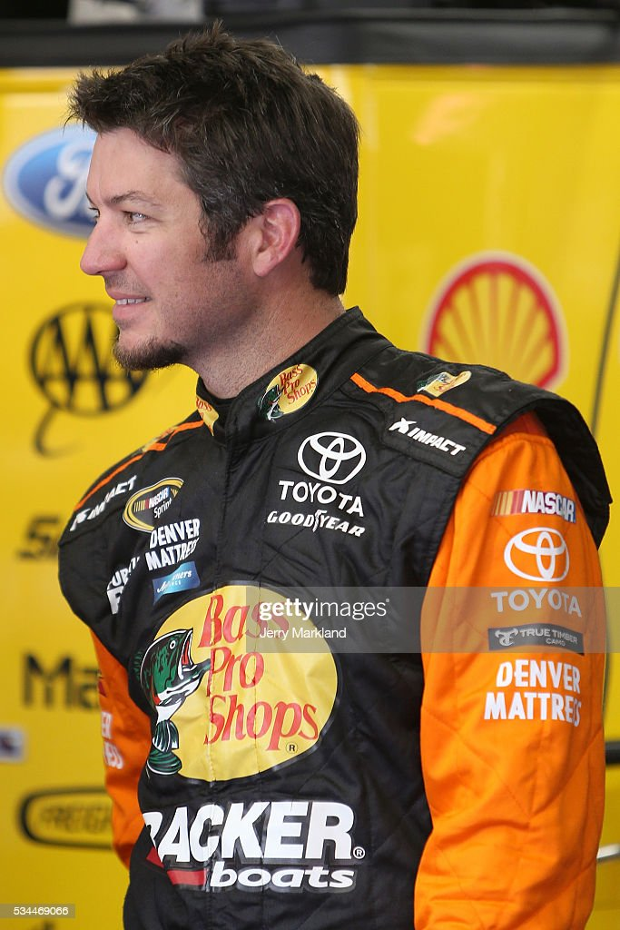 <a gi-track='captionPersonalityLinkClicked' href=/galleries/search?phrase=Martin+Truex+Jr.&family=editorial&specificpeople=184514 ng-click='$event.stopPropagation()'>Martin Truex Jr.</a>, driver of the #78 Bass Pro Shops/Tracker Toyota, stands in the garage area during practice for the NASCAR Sprint Cup Series Coca-Cola 600 at Charlotte Motor Speedway on May 27, 2016 in Charlotte, North Carolina.