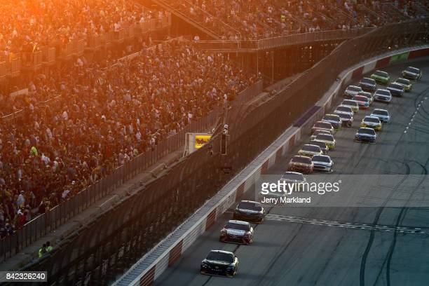 Martin Truex Jr driver of the BassProShops/TrackerBoats 40th Anniversary Toyota leads a pack of cars during the Monster Energy NASCAR Cup Series...